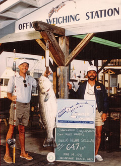 Captain Mike Harris (above right) shown with the former State record trophy rockfish